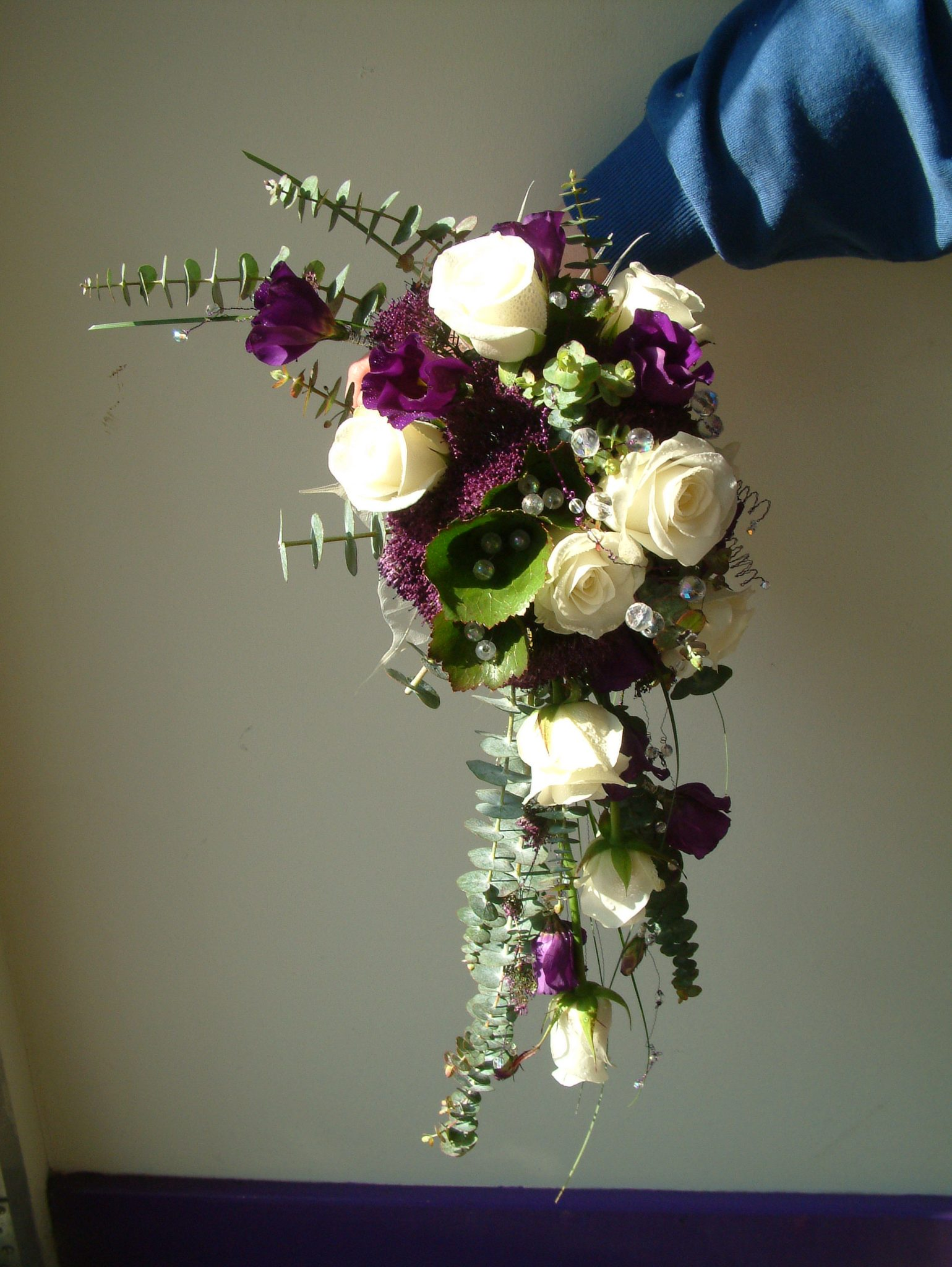 Crescent bridal bouquet in purples and whites bay tree for Crescent bouquet